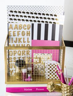 Deck your office space out in black, gold, and hot pink for a trendy style.