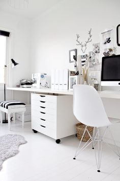black and white home office. wall length desk to fit two work spaces?