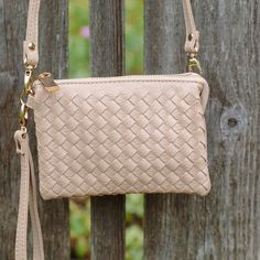 Woven Crossbody Handbag Wonderful small crossbody bag.  Love the woven detail and neutral tan color.  Excellent bag for when you want to be hands free! Boutique Bags Crossbody Bags