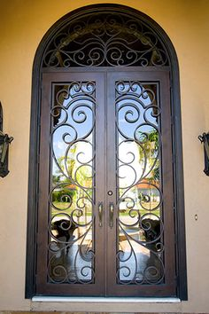 Custom iron front door, not a fan of the color of the house, maybe a light grey over brown/ orange