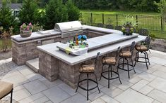 For an outdoor kitchen that perfectly matches your landscape, see the Techo-Bloc Grill Island www.techo-bloc.com