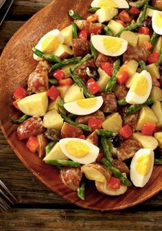 Nicoise Potato Salad — Up your potato salad game with this Nicoise-style recipe for a crowd. Its hearty appeal comes from hard-cooked eggs, zesty olives and fresh green beans.