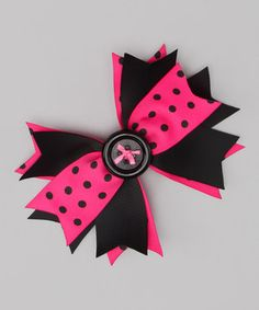 Polka dots and a button center dare to be darling on this prim clip. Layers of ribbon shape into the kind of bow that's sweet on every giggly girl.