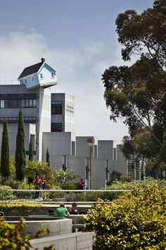 "This installation ""Fallen Star"" was designed by artist Do Ho Suh. perched 100 feet atop Engineering Bldg 1 on the U of California San Diego campus. The house is fully furnished. A rooftop garden that leads to the entrance of the cottage was also added. Check out the link to other photos!"