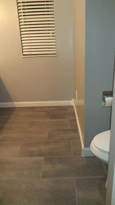 TrafficMaster Ceramica 12 in. x 24 in. Coastal Grey Vinyl Tile Flooring (30 sq. ft./case)-24716 at The Home Depot
