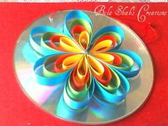 Light topic: shiny CD's to decorate with paper flowers or beads, then hang up with loop glued to back Quilling Flowers, Paper Quilling, Paper Flowers, Quilling Ideas, Cd Crafts, Arts And Crafts, Paper Crafts, Diy For Kids, Crafts For Kids