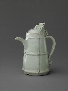 Tibetan-Style Ewer, 14th century, Yuan dynasty (1271–1368), China. Porcelain (Qingbai ware); H. 9 13/16 in. (24.9 cm), Diam. of rim: 3 9/16 in. (9 cm), Diam. of foot: 4 7/8 in. (12.4 cm).   Found in the tomb of a Kashmiri monk whose son was Yuan official in the early fourteenth century.