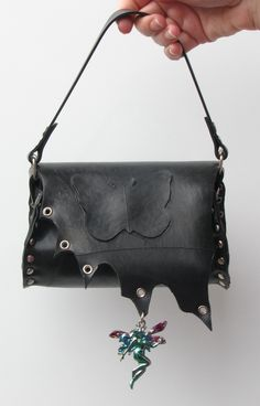 """Magically created using inner tube rubber in the """"tiny bag"""" style so you stay on top of trends, while you stay connected to your inner child.  Mirror, mirror on the wall, what's the cutest bag of all? This faerie tale bag of course, wave your wand and make it yours! ☺ #yyldeals #handbag #black #unique #studded #accessories #onlineshopping #creatorsmarket #fashion #purseaddict #purselover #accessory #bag #purse #shopping #fashiondesign #handbags #vegan"""