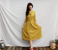 A rich yellow wool dress would be just the thing for fall.