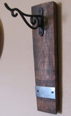 Wine Barrel Stave Plant or Lantern Hanger with 1 Barrel Strap 12 inches. $21.73, via Etsy.