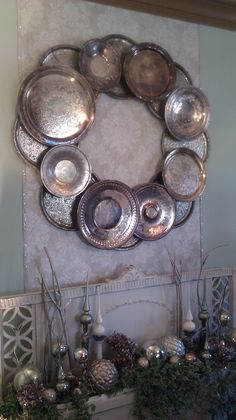 DIY wall decor using old silver serving plates. From Bachman's Idea House (Minneapolis, MN).