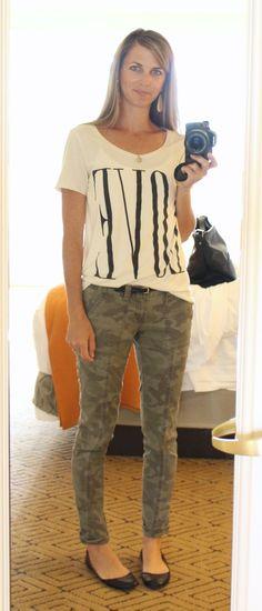 graphic tee, camo pants, black flats