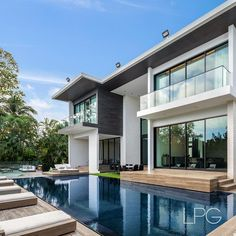 """Lifestyle Production Group on Instagram: """"Enjoy the best of Both Worlds in this Miami Beach Modern in Coral Gables' gated amenity-rich Islands of Cocoplum. Photography by:…"""" Coral Gables, House Goals, Miami Beach, Mansions, Architecture, House Styles, World, Islands, Photography"""