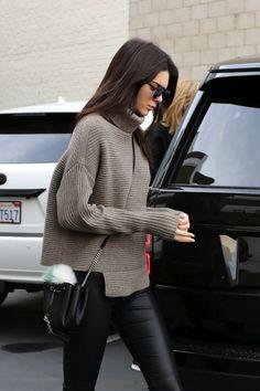 Le Fashion Blog Model Off Duty Style Kendall Jenner Ribbed Asymmetrical Turtleneck Knit Small Bucket Bag With Fur Pom Pom Leather Leggings Via Kendall-Jenner.net