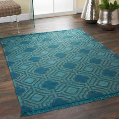 Overdyed Wool Flatweave Maze Rug  Vibrant color in a timeless geometric trellis pattern makes a stunning accent rug for any room. Select a rich peacock Teal or luscious berry Pink. 100% wool. Hand woven