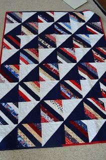 The movement in this quilt caused by the black HST's and the black strip in the string blocks is stunning ~