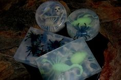 I melted some glycerin soap in a double boiler, poured it into plastic soap molds (you can use a loaf pan in a pinch, you'll just need to slice wedge into individual soaps, or use small plastic storage containers) , then added a few glow in the dark bugs, scary spiders, and skeleton bones (is that redundant?), popped it in the fridge for a short while, and VOILA!...ghoulishly good glycerin soaps for the powder room.