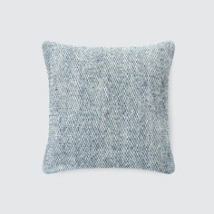 "Hand-loomed using ""wild"" spun yarn from Donegal, this tweed pillow features a textured, dappled look that highlights its various shades of blue."