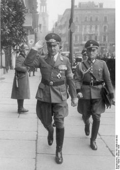 Arthur Greiser (man saluting) was Reich Governor in occupied Poland and the protagonist of organizing the destruction of Polish Jewry and numerous other war crimes. He was arrested by US forces after the war and he was tried and hanged in Poland in 1946.