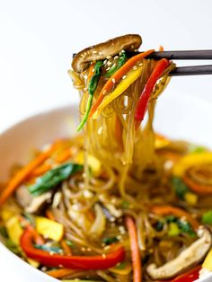A simple, easy recipe for Japchae, also known as Korean glass noodles with stir fried vegetables. It's made with sweet potato starch noodles, colorful vegetables and tossed in a savory sauce! #japchae #Koreannoodles #glassnoodles #drivemehungry | drivemehungry.com Korean Sweet Potato Noodles, Korean Glass Noodles, Fried Vegetables, Colorful Vegetables, Easy Korean Recipes, Japanese Recipes, Japchae Noodles, Korean Red Pepper Flakes, Cellophane Noodles