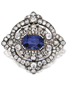 Gold, Silver, Sapphire and Diamond Brooch, Circa 1870. Centered by an…