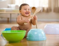 Kitchen activities –  Spoons and Scoops:- Take the crockery: a knife, a spoon, a fork, a plate, a saucepan, a frying pan, a cup, a tea-pot. Let your baby study them, knock them on the table. Then take a little plastic stick and let your baby beat on all the crockery.   Hiding game:- Hide every object under the saucepan asking: where is the spoon? Here it is! Open the saucepan.   Beans and Cereals Activity:- Take several trays and bowls, spread there different cereals and beans. At first let your baby decide himself what to do with them. Then help him draw shapes on the trays, knead cereals and beans in the bowls.