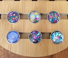 Snap Jewelry Snap Charms, Flowers and Swirls Snap Charms for Snap Jewelry. Fits 18-20mm Gingersnaps, Noosa, Magnolia & Vine, Chunks, Silvertone Metal, Glass.  Button #s run left to right by rows.  Fits 18mm-20mm Gingersnaps, Noosa and other snap button jewelry and charms.  Trendy & fun snap button jewelry lets you create one-of-a-kind jewelry in a snap with interchangeable jewelry pieces & snap button charms.  See our listings - we have hundreds of beautiful snap charms.  Item is ...