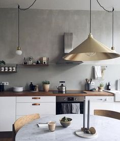 Our Berlin minimal white kitchen with industrial scandinavian elements and marble table.