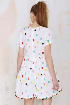 One day... maybe a little nod to my childhood dresses with their pom pom hems.
