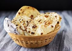 Naan ~ Learn to make a restaurant-quality version of the versatile Indian flatbread at home.