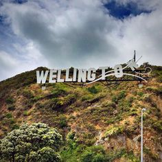 This photo shows where I am from, which is Wellington, New Zealand. This sign is designed to be like the Hollywood sign but also represent that Wellington is the windiest city in the world. Wellington City, Wellington New Zealand, Moving To New Zealand, New Zealand Travel, Places To See, Places Ive Been, New Zealand North, New Zealand Houses, To Go