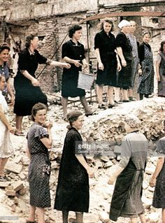 "Unsung heroines, ""Trümmer - Frauen"" are collecting usable bricks from a ruin to rebuild the city. July 1945. Most were paid with a hot meal. More than 300 bombardments by the British Royal Air Force and the United States Army Air Forces took place in the period from June 1940 to the end of the war in 1945 and left most of the city in ruins. Berlin, Germany."