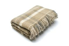 Tartan Throw A lovely soft lambswool throw in a light fawn and beige, perfect to throw over your sofa, or snuggle under on a wintery evening...