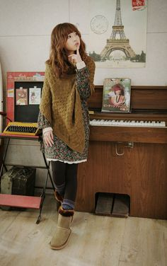 Mori, cute: Brown, yellow, knitted poncho. Dark gray dress with red and green flower pattern. Black stockings. Multicolored socks. Beige suede boots with brown faux fur details.