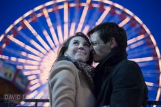 It was November, and getting chilly as it got dark.  I loved this sweet moment, when he was warming his nose!  Engagement picture at Chicago's Navy Pier, with Ferris wheel in the background, at night.  Photo by David Ettinger.  http://davidettinger.com