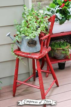 Red Kitchen Chair with Watering Can Planter