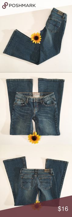American Rag Super Flare denim jeans, 5 short Very good used condition American Rag jeans in a size 5 short. Super flare. Very little wear to the hems, most of the wear is factory wear. Worn several times but still plenty of life left. Waist- approximately 13 3/4 inches, rise- approximately 7 inches, inseam- approximately 28.5 inches. American Rag Jeans Flare & Wide Leg