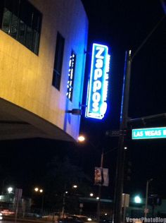 Zappos Neon Sign At Night