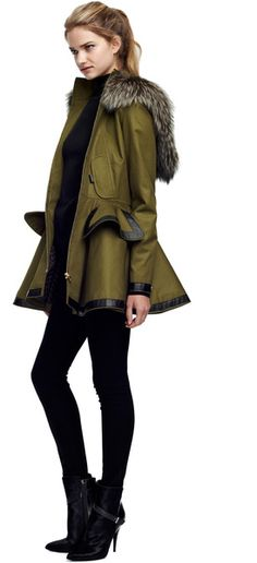 PRABAL GURUNG Peplum parka in olive cotton twill with black patent leather trim, dyed silver fox fur trim at hood, and dyed brown rabbit fur hood lining.