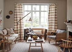 Neutral Living Room with Blanket Curtains and Wooden Furniture