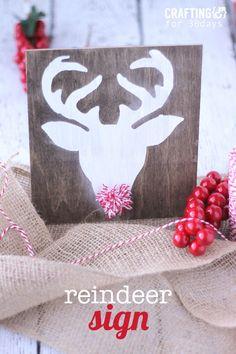 Reindeer sign with a cute pom pom nose. Cute Christmas decor idea on www.thirtyhandmadedays.com