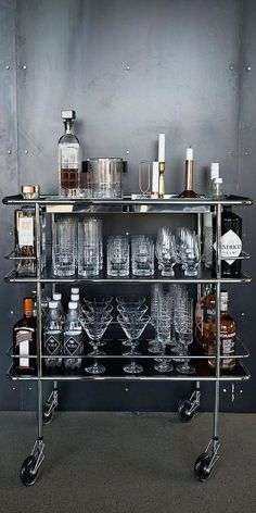 A Home Bar is an essential element to your game room, man cave, or wherever you want to entertain in your home. We offer plenty of classy and fun bar furniture ideas for the home, including all the accessories you'll need like bar stools and wine racks. Mini Bars, Bar Cart Styling, Bar Cart Decor, Silver Bar Cart, Bar Trolley, Drinks Trolley, Beverage Cart, Cool Apartments, Apartment Kitchen