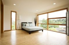 Bedroom:Cork Flooring Bedroom - Perfect Choice For Durability And Aesthetic Value Ultra Light Bedroom Style With Cork Flooring And Large Windows Also Black Low Platform Bed