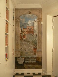 3D mural painted in a hallway.