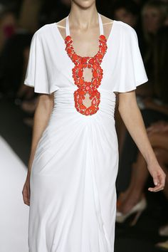 Close up of a matte jersey dress with coral chunky neckline I designed for badgley mischka spring 2010