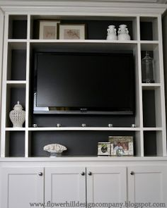 I love how the TV recedes into this built-in with the back wall painted charcoal grey.