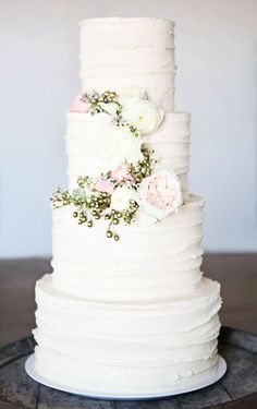 White wedding minimalistic layered tiered cake with floral details