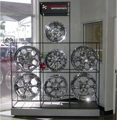 Such a great way to display these beautiful Tire rims! Abstracta Modular Displays #tiredisplay #retaildisplay