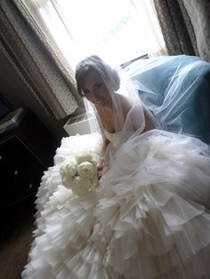 Bouquet by Socially Artistic Events complements the Brides Lazarro Couture dress from Catan Fashions.