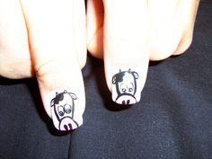 Cow heads nail art.